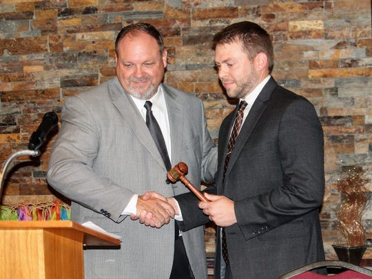 Past Chair Doyle Syling passed the gavel to new Chair of the Chamber Board of Directors, Reid Griggs, Thursday afternoon at Pepper's Grill.