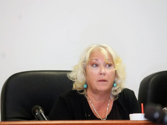 Former County Attorney Lisa Jenkins gives advice to County Commissioners at their regular meeting July 13.