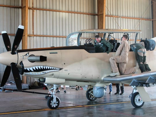 Chief of Staff of the Air Force Gen. David L. Goldfein prepares to get off of an AT-6 Wolverine that he flew during the day at Holloman Air Force Base Wednesday.