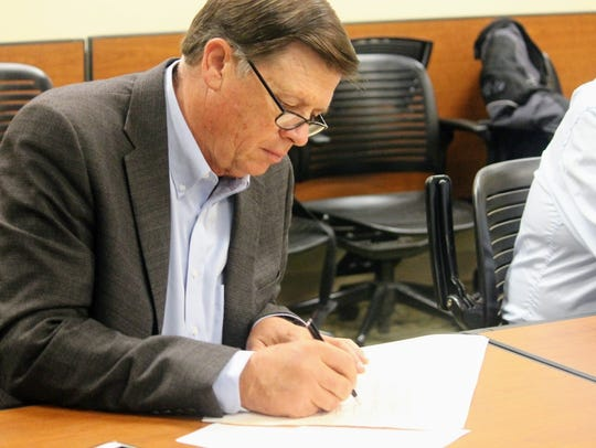State Land Commissioner Aubrey Dunn signs the Sacramento