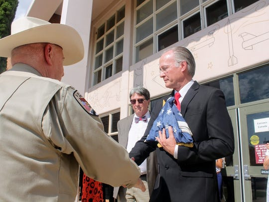 Twelfth Judicial District Court Judge Jerry H. Ritter Jr. is retiring after 20 years. Ritter took the flags that were in his name up at the court house Tuesday during his retirement ceremony.
