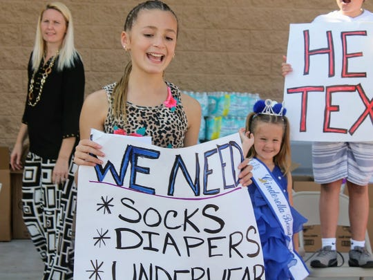 Isabella Haas, 10, encourages residents to donate items