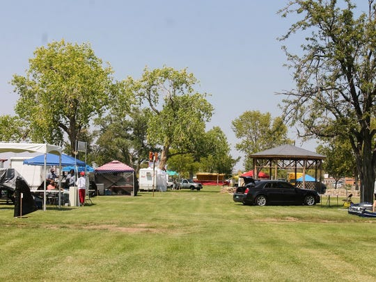 Vendors set up their booths at Alameda Park Friday