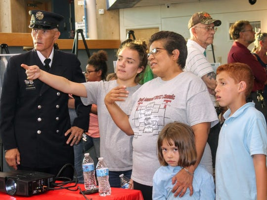 Retired Schenectady, New York Police Officer and Volunteer Fire Chief John Borowski educates residents on the impact of the Sept. 11, 2001 terror attacks on the United States Monday at the New Mexico Museum of Space History.