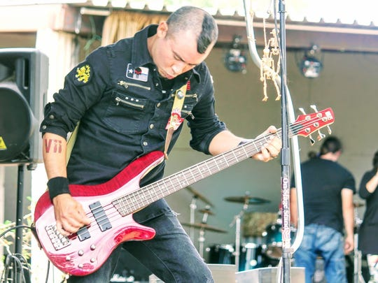 Alex Aguilera, bassist for SeVIIN, rocks out at 2017 Harvest Fest at Horror Hall Saturday.