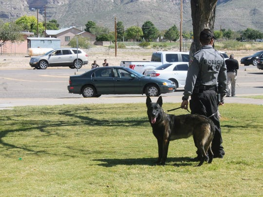 Alamogordo Police Department's K-9 unit was on the scene at Alamogordo High School Tuesday afternoon due to reports of a man walking around the football field with a holstered firearm.