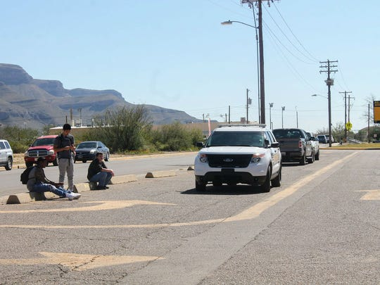 Students wait outside Alamogordo High School until they are allowed to go back inside the building Tuesday afternoon.