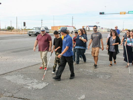 A group of visually impaired students and residents cross the street at Indian Wells Road and White Sands Boulevard Wednesday afternoon.