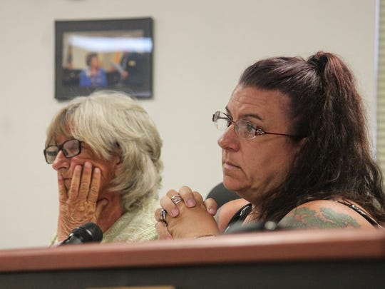 From left to right, County Commissioner Janet White and Commission Chairman Lori Bies listen to public comments on the drafted Ordinance No. 18-02, Fireworks Safety and Use Wednesday at their public hearing.