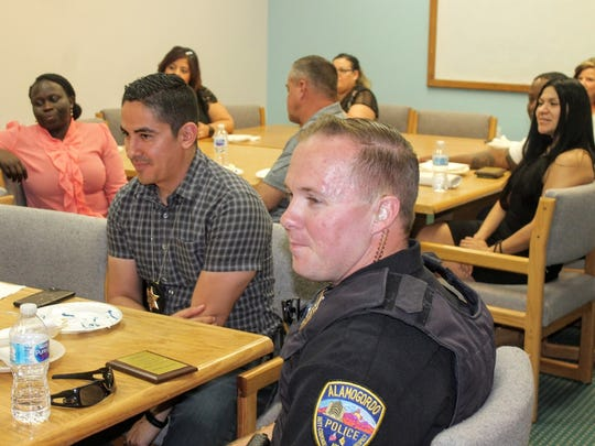 Otero County Sheriff's Office deputy Sam Montoya and Alamogordo Police Department officer John Goepfert were both honored by the New Mexico Children, Youth and Families Department (CYFD) Tuesday for their work with children and families in need.