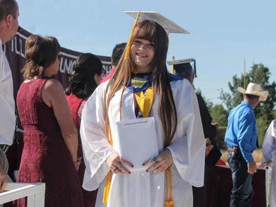 Tularosa High School Valedictorian Ashley Yarborough stands for a photo after receiving her diploma.