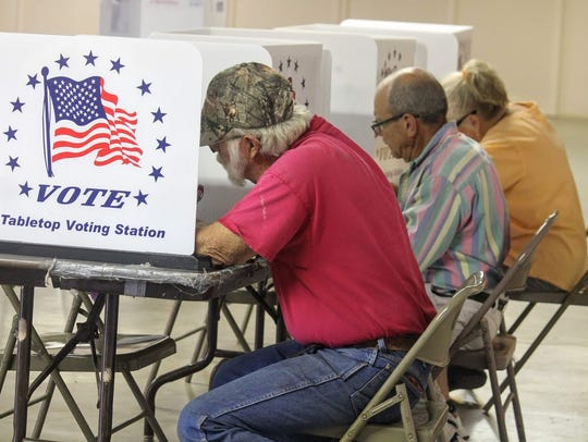 Voters cast their ballot at the Otero County Fairgrounds