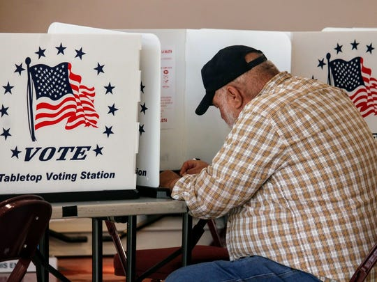 An Otero County resident casts his ballot at the Tays
