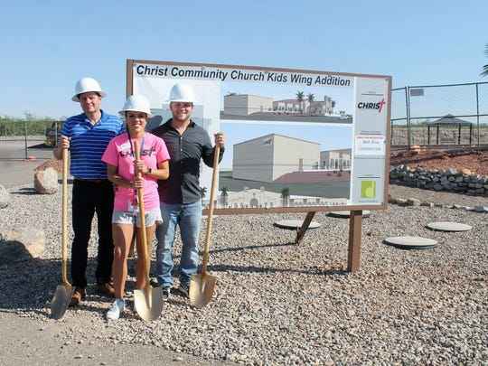 Christ Community Church pastoral leaders Eric Lucero, LeAnn Brock and Timothy Brock stand for a photo for the groundbreaking of the church's new children's wing.