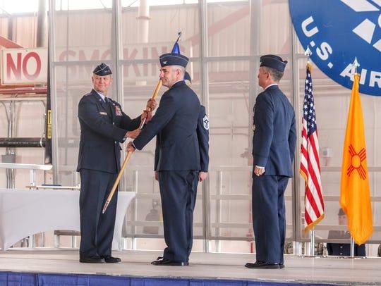 Lt. Gen. Mark D. Kelly, 12th Air Force commander, hands