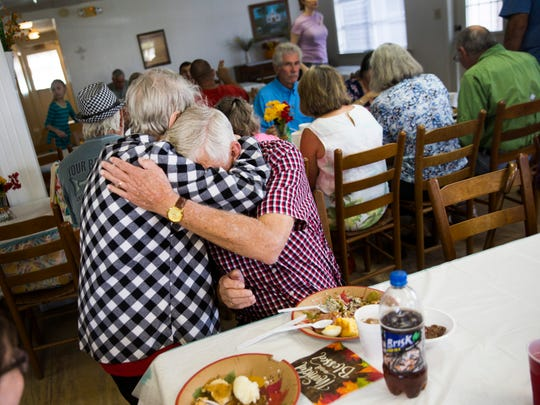 Capt. Bill Miller hugs Chokoloskee resident Dorothy Weeks during a Thanksgiving dinner on Thursday, Nov. 23, 2017, at the First Baptist Church of Everglades City.
