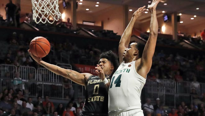 Florida State guard Rayquan Evans (0) shoots the ball against Miami center Rodney Miller Jr. (14) during the first half Saturday in Coral Gables.