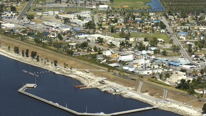 An aerial view looking eastward at the city of Pahokee, with the Herbert Hoover Dike in the foreground.