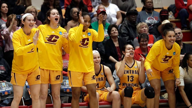 Central Michigan's bench celebrates late in the second half of CMU's 78-69 win in the first round of the the NCAA women's tournament, Saturday, March 17, 2018, in Columbus, Ohio.