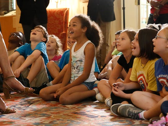 """Children from Roberts Elementary School react to the story """"Dragons Love Tacos"""" being read aloud by Florida First Lady Ann Scott at the Governor's Mansion on Monday."""