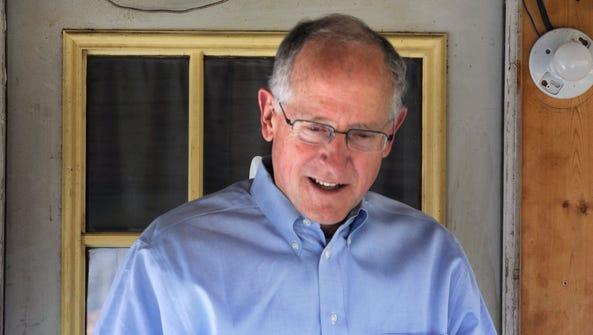 Congressman Mike Conaway steps away from a door after