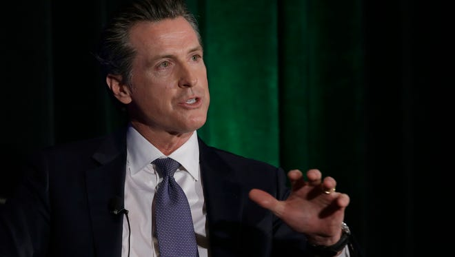 In this March file photo, Gavin Newsom discusses the state's housing problems at a conference in Sacramento.