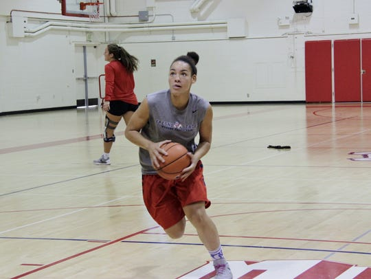 Fresno State junior Candice White works on her layups