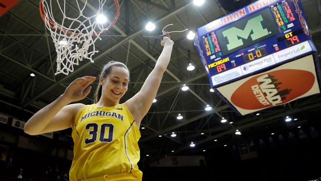 Michigan center Hallie Thome cuts the net after the WNIT championship game against Georgia Tech, Saturday, April 1, 2017 at Calihan Hall in Detroit. Thome scored 25 points in U-M's 89-79 victory in 3 OTs.
