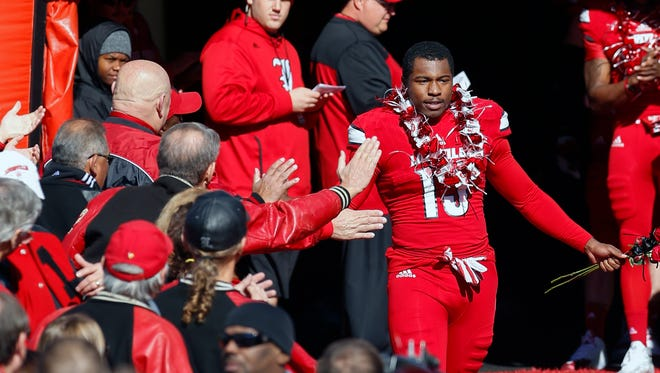 Louisville's James Burgess is honored on senior day.