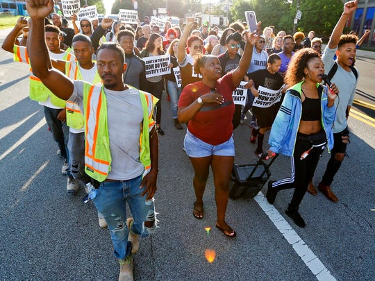 People start a protest march against the shooting death