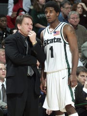 Marcus Taylor talks things over with Tom Izzo during the second half in East Lansing on March 2, 2002.