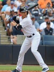 Yankees right fielder Giancarlo Stanton (27) at bat during the Tigers' 3-1 exhibition loss to the Yankees on Friday, Feb. 23, 2018, in Tampa, Fla.