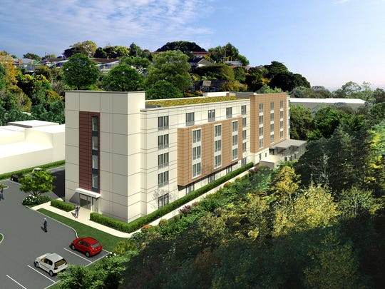 An artist rendering of the rear of the Marriott SpringHill Suites hotel at 109-125 Marbledale Road with the nearby residential neighborhood in the background.