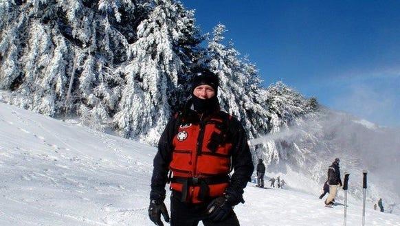 A member of the Cataloochee Ski Patrol takes a break