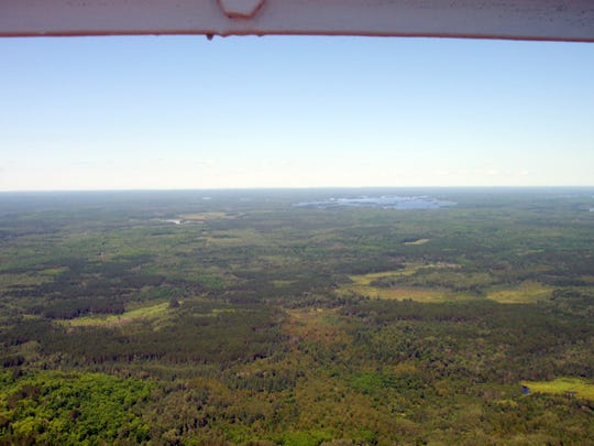 A view of the Chequamegon-Nicolet National Forest from a 1,400-foot Wisconsin Educational Communications Board television tower in Park Falls, Wisconsin. The tower has for more than a decade hosted atmospheric instruments that gather data on humidity, temperature, greenhouse gases like carbon dioxide and methane, and more. They are operated by University of Wisconsin–Madison Professor of Atmospheric and Oceanic Sciences, Ankur Desai and collaborators.