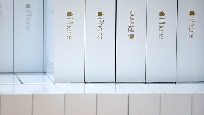 Apple iPhone 6 phones are stacked up for customers to purchase at the Apple Store during the launch on Sept 19 in Palo Alto, Calif.