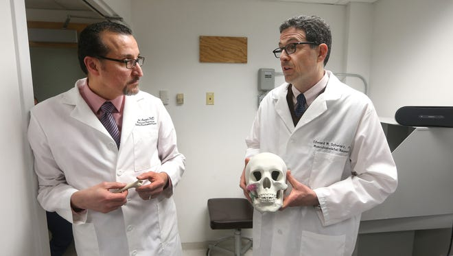 University of Rochester Medical Center Scientists Hani Awad, left, and Edward Schwarz explain how they are leading the way in using 3-D printing and stem cells to create bone replacements for patients.