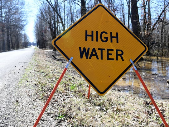 A high water sign is posted on Roberts Station Road