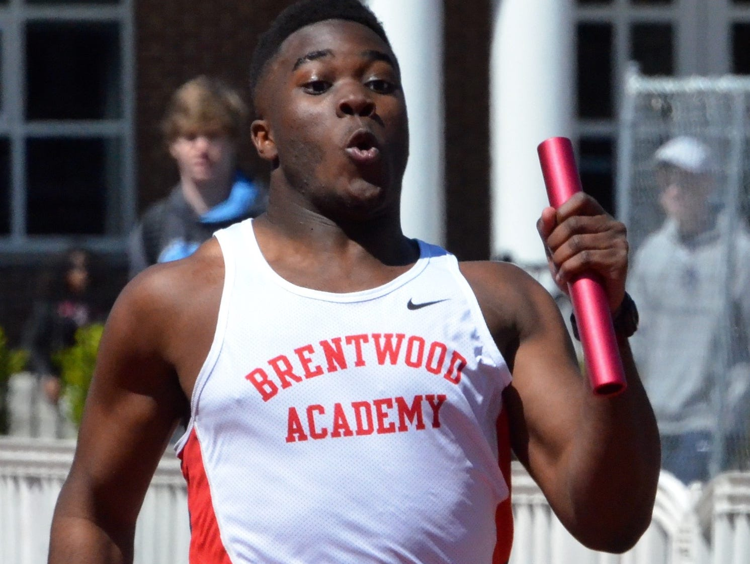 Brentwood Academy's Prince Momodu competes in the 400-meter relay.