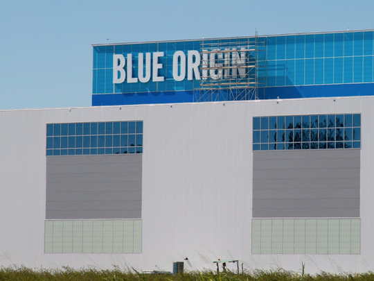 Blue Origin's logo is seen on its New Glenn factory at Kennedy Space Center's Exploration Park in October 2017.