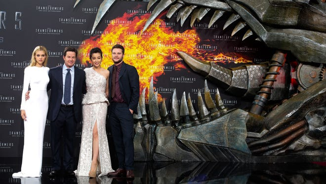 "From left, actors Nicola Peltz, Mark Wahlberg, Li Bingbing, and Jack Reynor pose for photographers, during the European premiere of the film ""Transformers: Age of Extinction,"" at Potsdamer Platz in Berlin on June 29, 2014. Transformers"" is rolling out with the most nominations at this year's Golden Raspberry Awards."