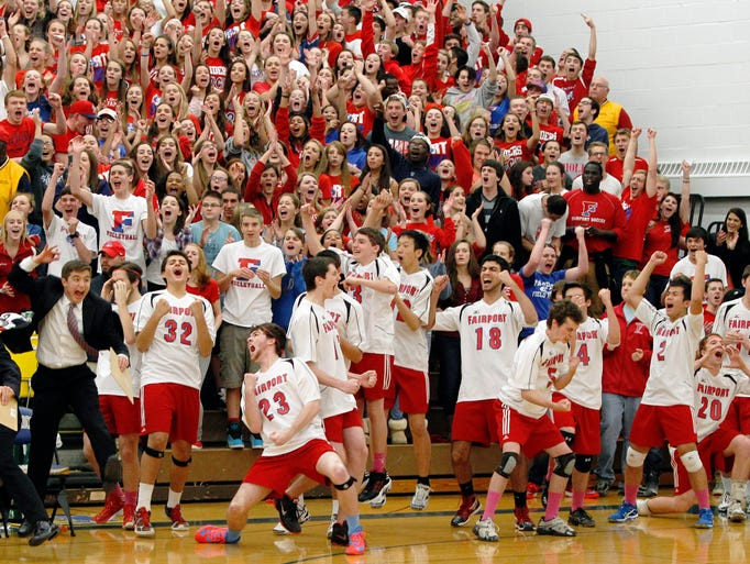 Fairport boys volleyball players and fans celebrate against McQuaid.