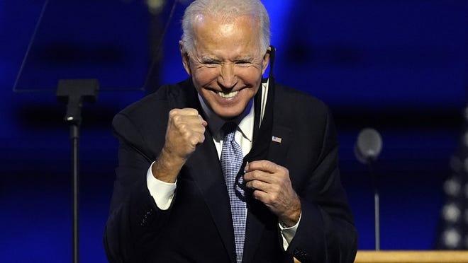 President-elect Joe Biden gestures to supporters Saturday, in Wilmington, Del.