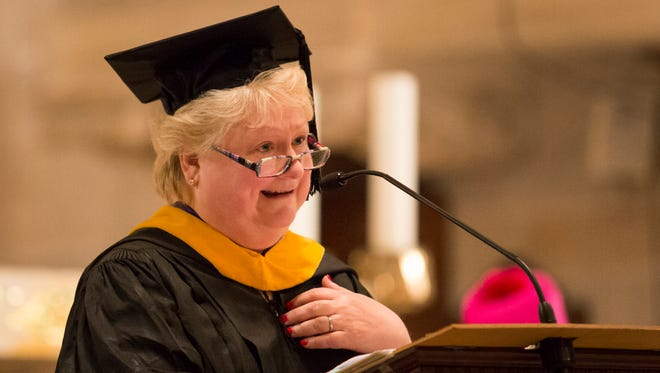 Head of School Cindy Hayes Mann delivers her remarks during graduation ceremonies for Padua Academy at St. Anthony of Padua Church in May 2015.