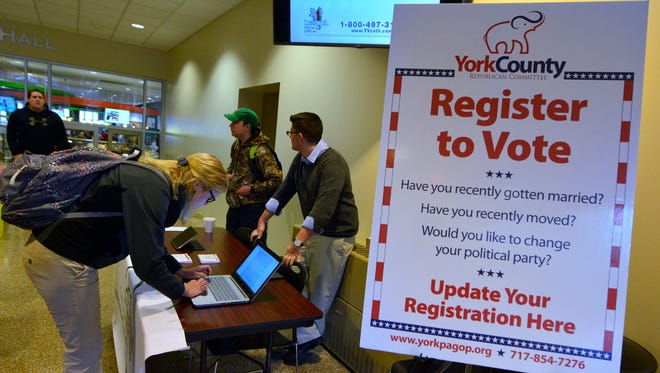 The York College Conservative Forum holds a voter registration booth in the Student Union building during lunch, Monday, March 14, 2016. John A. Pavoncello photo