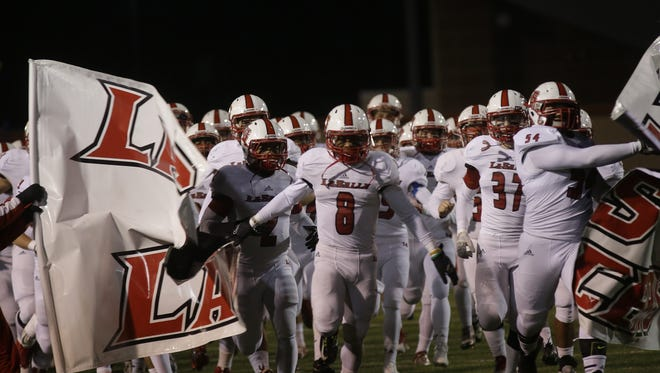 La Salle runs onto the field before the Lancers' regional final at Welcome Stadium on Friday against Olentangy.