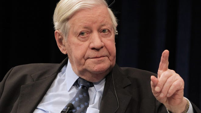 Helmut Schmidt makes a gesture during a discussion hosted by the ECB in Frankfurt, Germany. Helmut Schmidt died Nov. 10, 2015. He was 96.