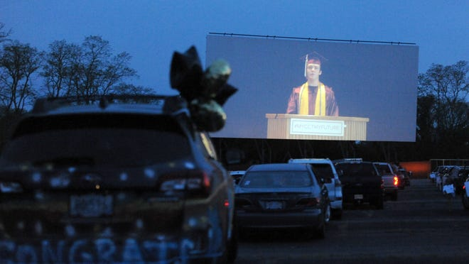 Co-valedictorian Mark Gorman's prerecorded speech is shown on the big screen at Wellfleet Drive-In Theatre during Thursday's graduation ceremony for Cape Cod Regional Technical High School.