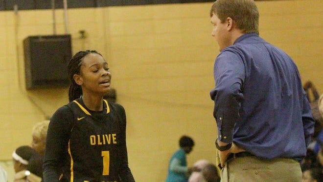 Blake Jones talks with Olive Branch's Myah Taylor (1) during the MHSAA state tournament game against Starkville in February.