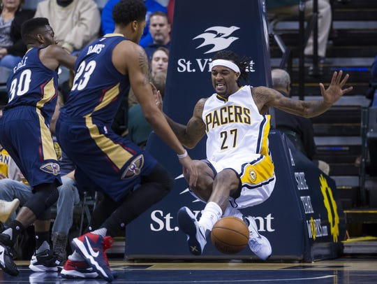 Indiana Pacers' Jordan Hill (27) is fouled under the